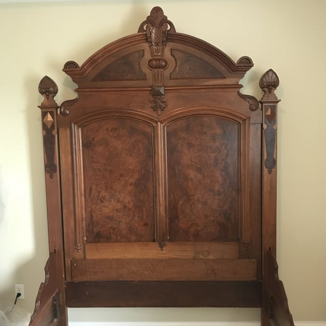 Gorgeous Eastlake Full Size bed. Has intricate carvings on the headboard and footboard. Beautiful walnut and burlwood bed....