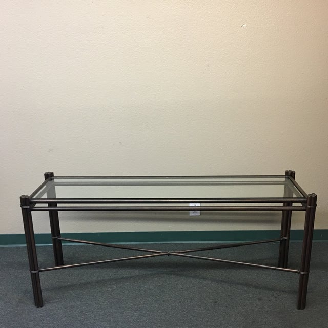 Design Plus Gallery has a Kolkka iron console table. The table has a beautiful Bronze finish which almost makes the piece...