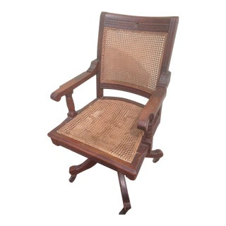 Early 20th Century Vintage Gunlocke Style Caned Dark Walnut Bankers Office Swivel Chair For Sale