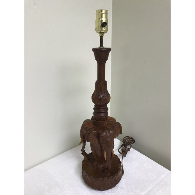 Handsome 1960s vintage teakwood hand carved table lamp featuring three elephants with tusks. Works!