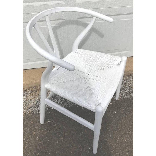 Set of four Hans Wegner Wishbone chairs, CH24. In white. The entire chair is polychromed/stained/cerused in white, as we...