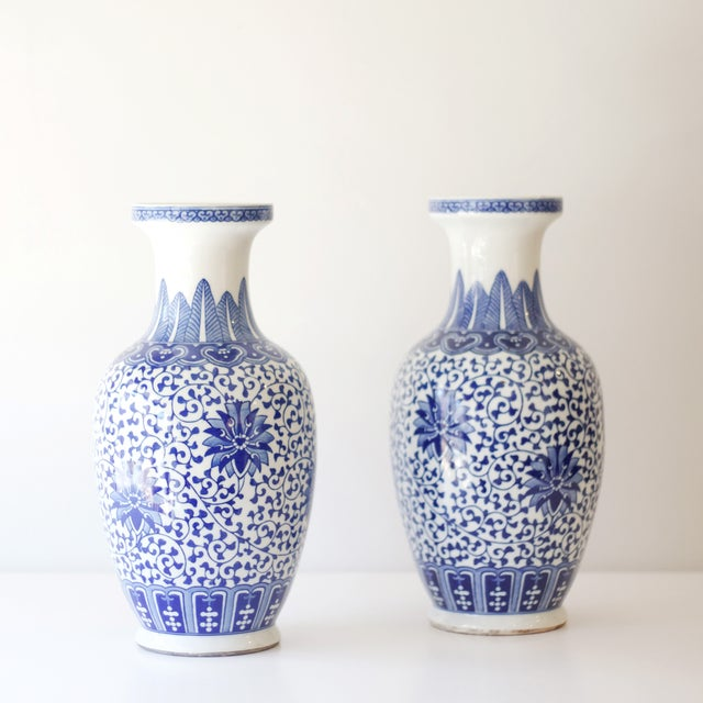 This beautiful pair of vases will steal the show in your home! The detailed blue and white pattern covers all sides of the...
