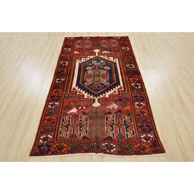 This is an authentic vintage Persian Luri rug hand-knotted in Persia with an all wool pile with abrash on a cotton...