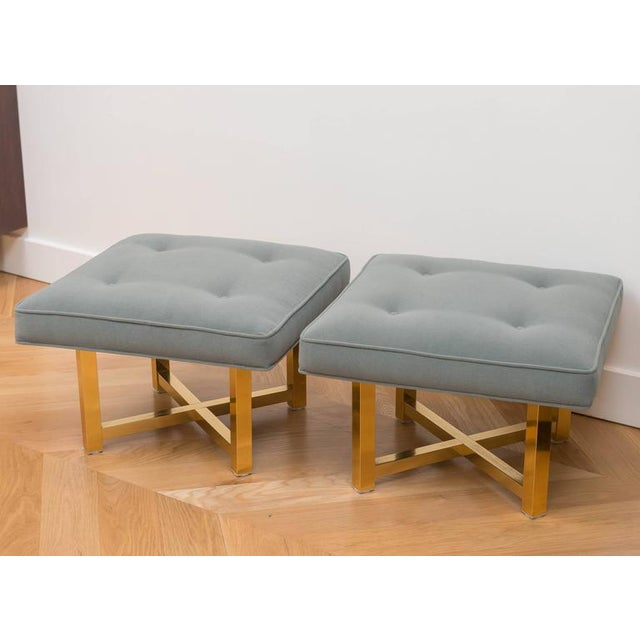 Chis pair of 80's low ottoman with brass plated bases. New alpaca wool fabric