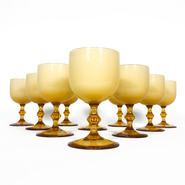 A set of ten cased glass wine goblets by Carlo Moretti. Made in Italy, these mid-century glasses have butterscotch colored...
