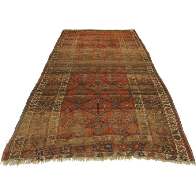 Offered is this antique Persian Kurdish Bijar rug. Made of hand-knotted wool. Lovely distressed look.