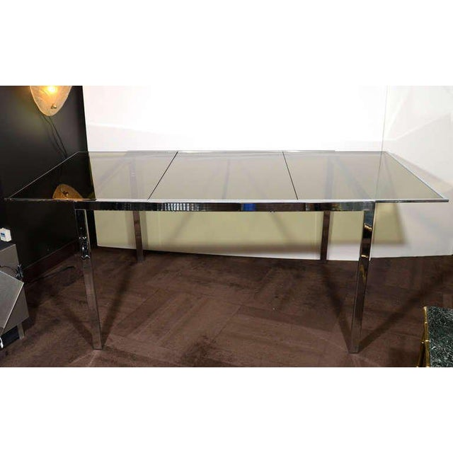 Milo Baughman for Design Institute of America, mid-century modern dining table with streamline design in chrome and with...