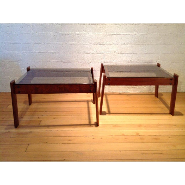A stunning pair of Brazilian rosewood side tables with inset glass tops by Percival Lafer. Both table retain the Lafer label.
