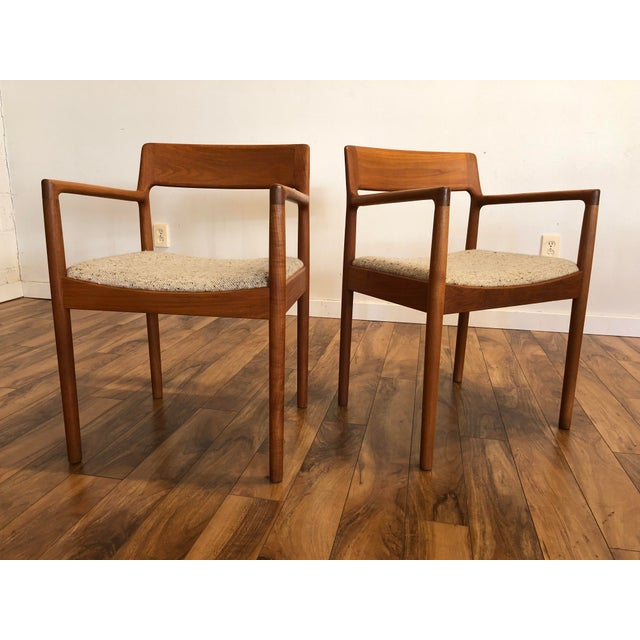 Pair of vintage Danish modern teak arm chairs by Johannes Norgaard. They're very well made, beautiful in their simplicity....