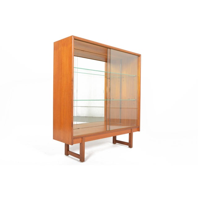 This English modern mid century bookcase was manufactured by Turnidge of London in the 1960s. This amazing piece features...