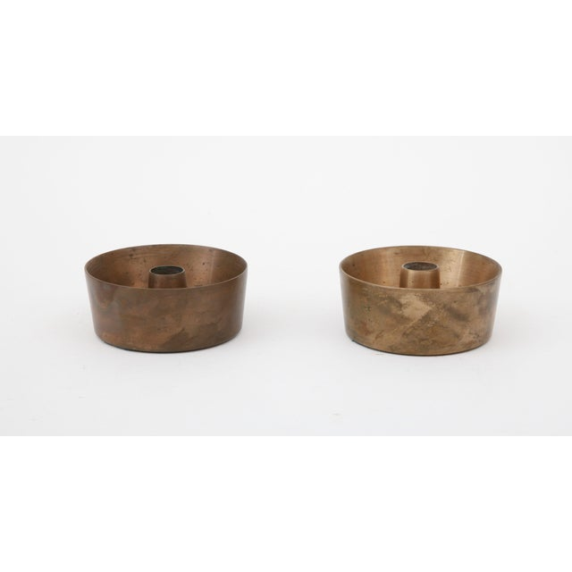 Heavy mid-century modernist brass candle holders with felt bottoms - natural patina.