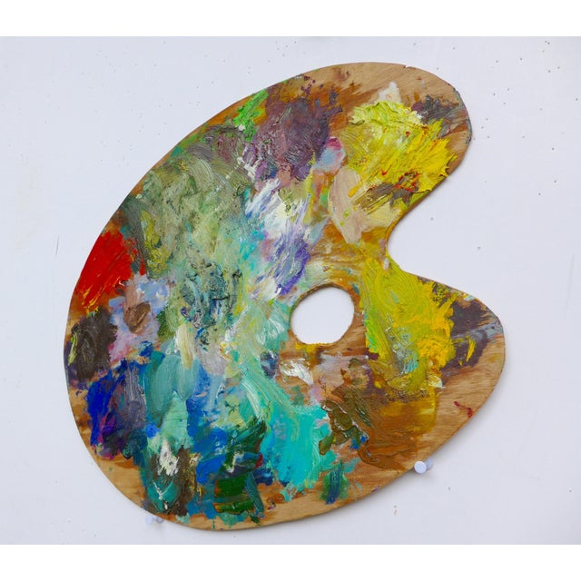 Original artist palette used for numerous oil paintings. An interesting decor item with a great pop of color.