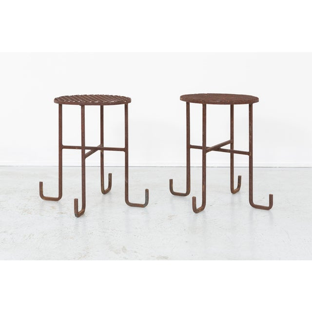 A set of two side tables. The designer is unknown. These were made in the USA, c 1960s, and feature rusted steel. Sold as...