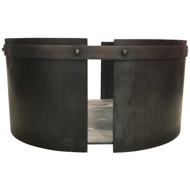Constructed from sturdy black iron, this modern firewood bin has a subtle oval silhouette that can cradle plenty of fuel...