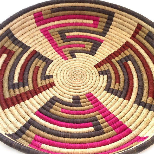 Geometric tray handcrafted from beautifully dyed sisal fibers and sweetgrass handcrafted in Africa using traditional...