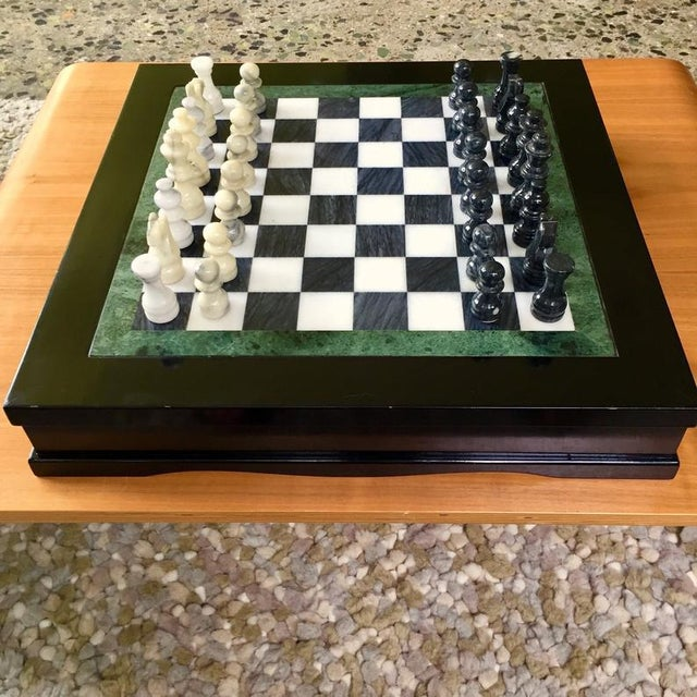 Amazing Vintage chess set circa 1970. A black lacquer box houses a drawer on each side for the marble game pieces. Drawers...