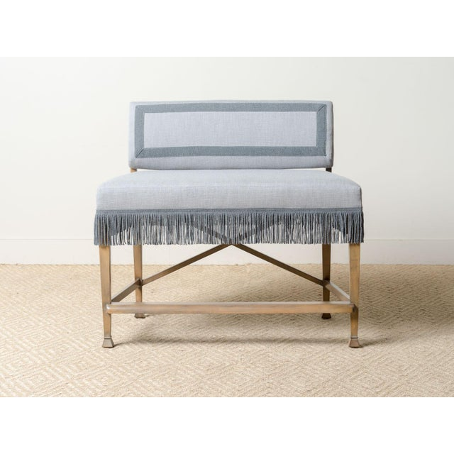 Upholstered counter bench Fabric: Outdoor Ishi Tin 100% Solution-Dyed Acrylic Contrast trim on inside and back Bullion...