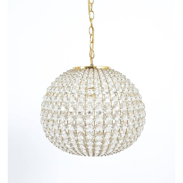 "Beautiful 16"" ball light from Austria. Handcrafted piece featuring a multitude of crystals in different sizes. It has been..."