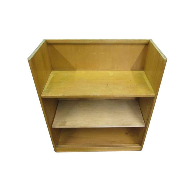 This is a vintage wooden book shelf with three shelves and an open top. One shelf is not original to this piece, this...