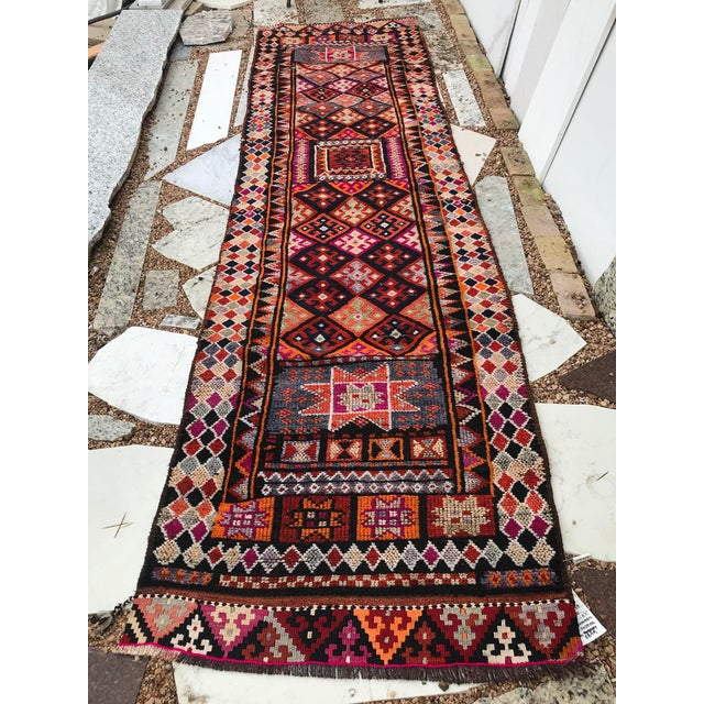 This rug is full of colors and nomadic motifs from eight point stars, to diamonds and ram's horms. The contrast of colors...