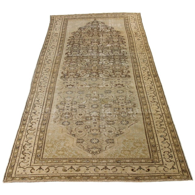 Antique Persian rug made by hand in the 1960s using the finest quality of wool and organic dyes. Created with design...