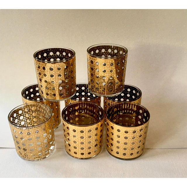 Vintage set of 8 gold cane motif cocktail glasses. These absolutely sparkle! Excellent condition. Shows little to no wear...