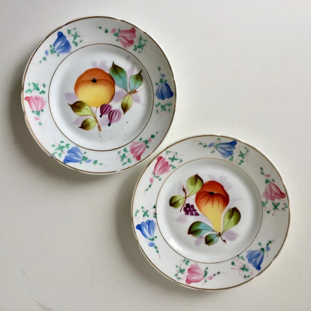This gorgeous set of four antique French porcelain fruit plates feature beautifully painted pears, cherries, gooseberries...