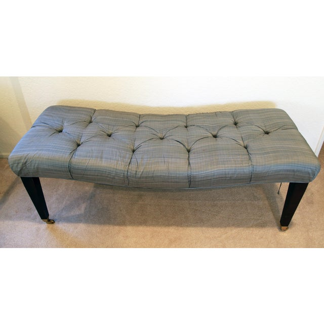 Whimsical tufted silk bench with curvy profile. Hardwood legs & frame. Sits on lovely brass casters /wheels.