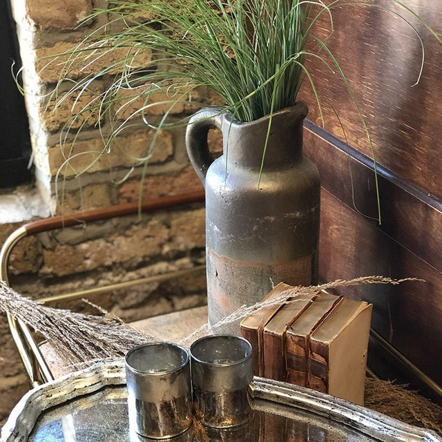 Rustic Clay Vase eludes time and exudes an ageless warmth and earthiness. The handled pitcher-vase manages a look that is...