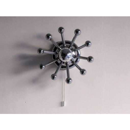 Petite chrome-plated ten-arm Sputnik sconces, single bulb with individual pull switch, can be used as ceiling lights.