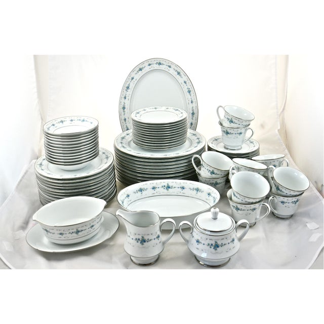 """Noritake floral porcelain dinner set with service for 12 plus five serving pieces. Set of: 12 dinner plates (10.5""""Dia); 12..."""