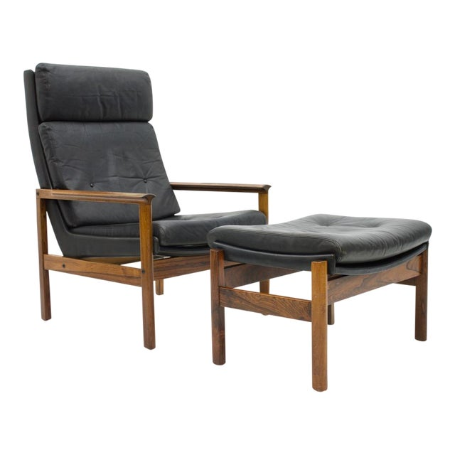 Scandinavian Lounge Chair With Stool in Rosewood and Black Leather, 1960s For Sale