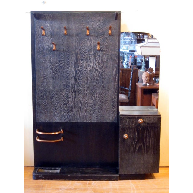 This is a French Art Deco hall tree/coat rack featuring ebonized cerused Oak. There is a glass shelf at the top, six...