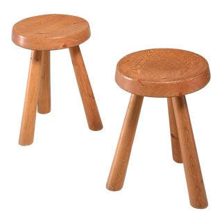 Charlotte Perriand pair of tripod pine stools from Les Arcs, France, 1960s For Sale