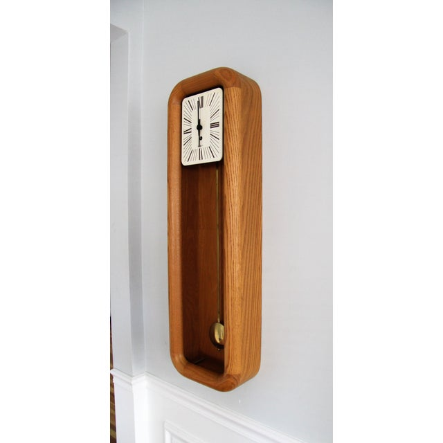 This is a solid oak circa 1975 Howard Miller mechanical pendulum wall clock. It is a model 612, has an 8-day winder and...