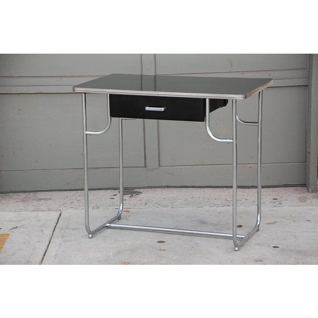 This listing is for a Lloyd Chromium Writing Desk by Kem Weber.