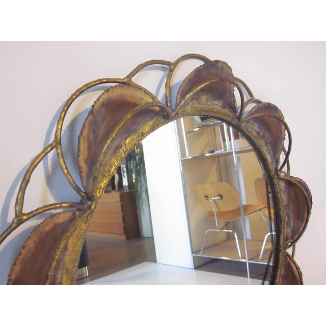 A Brutalist styled Curtis Jere wall mirror with welded and torch cut metal and rod design, signed Jere, 1970.