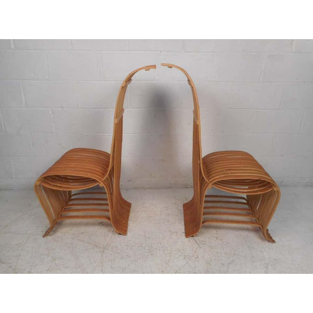 Interesting and unusual pair of wooden slat chairs. Quirky yet sturdy design. Great addition to any modern interior....