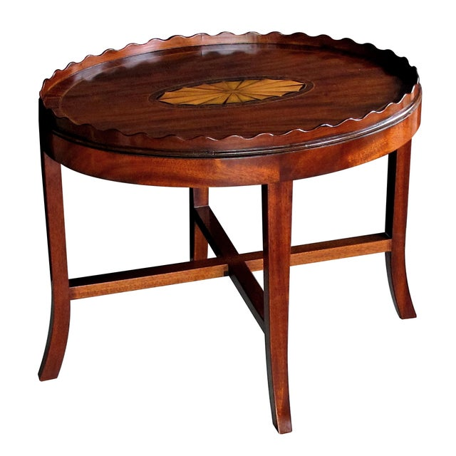 the large mahogany oval tray centering an impressive satinwood shell motif surrounded by rosewood banding; raised on a...