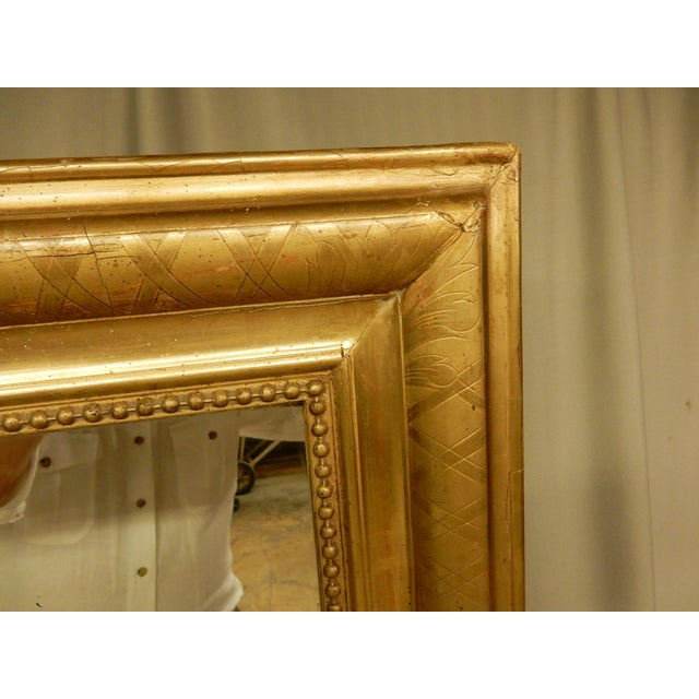 Very nice Louis Philippe mirror in rectangular shape. Quality gilding with crisscross etching on the gilding.