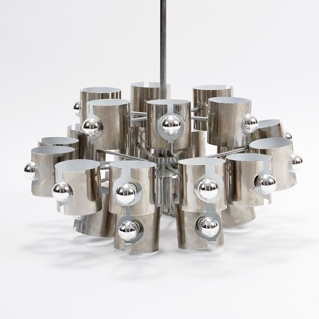 An unusual Italian mid-century modern chrome twenty five light chandelier circa 1960. Attributed to Sciolari, famed...