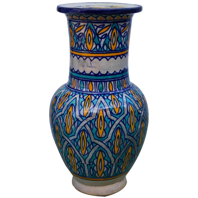 Antique handcrafted ceramic vase with an intricately hand-painted Moorish pattern in a traditional Andalusian color...