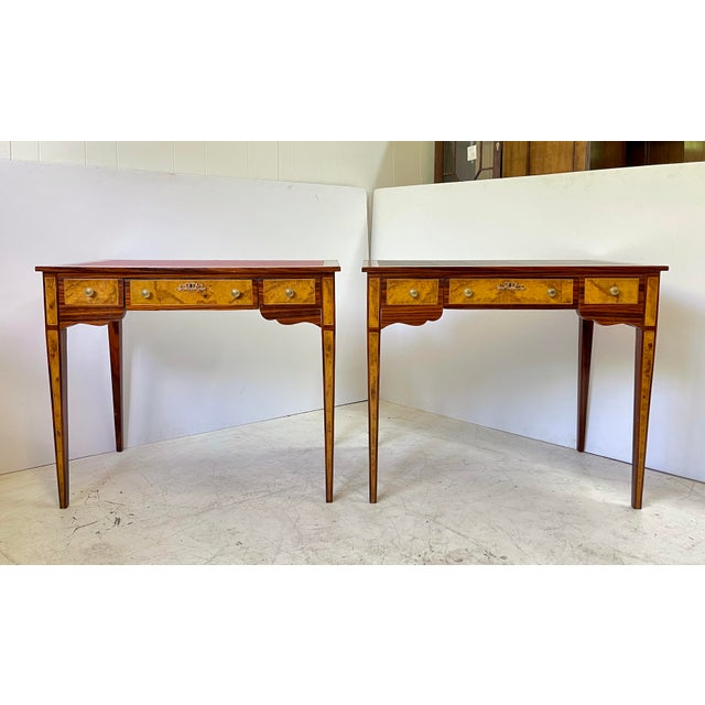 Fabulous and intricate pair of 20th Century neoclassical writing desks or side tables styled in burl wood veneers and...