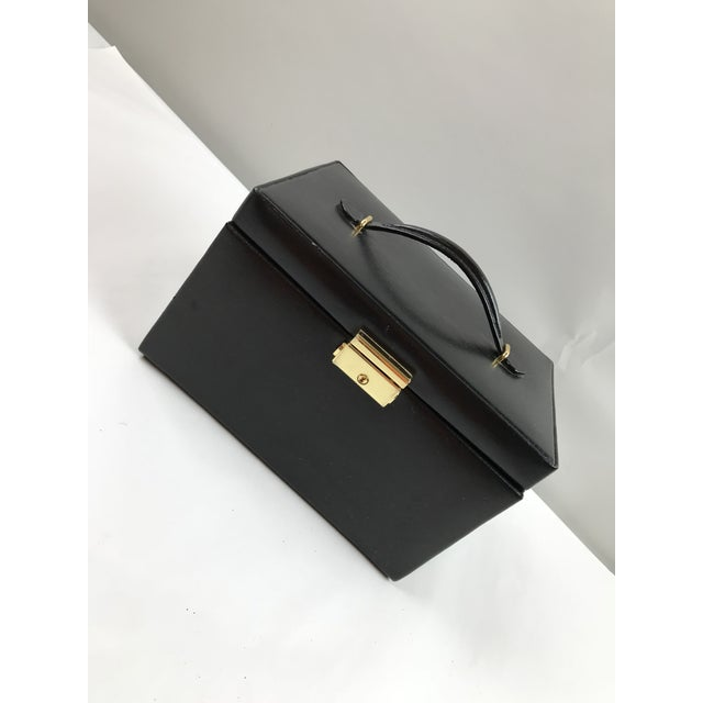 Pristine black leather jewelry case with original key. Clean with multiple removable components for travel, if needed....