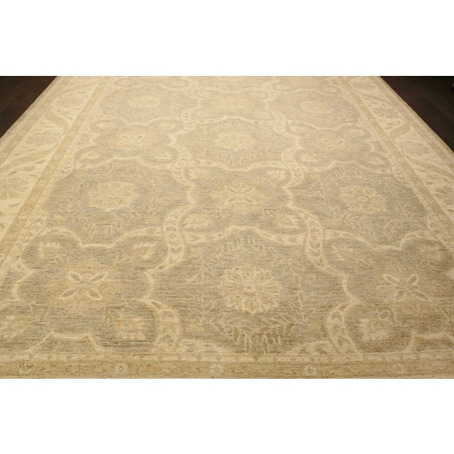 Vintage hand-knotted Peshawar rug with a multi medallion design in beige, this rug has a lot of detail and is ready for...