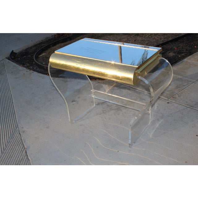 Mid century modern gold and Lucite vanity, possibly by Karl Springer. Note: we have the gold mirror that goes with this....