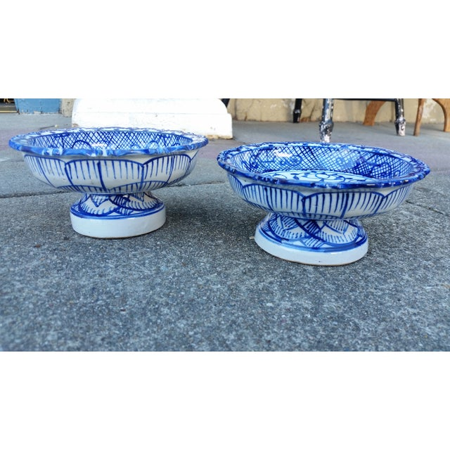 This lovely petite pair of footed terracotta bowls are glazed in blue and white and decorated with intricate line work and...