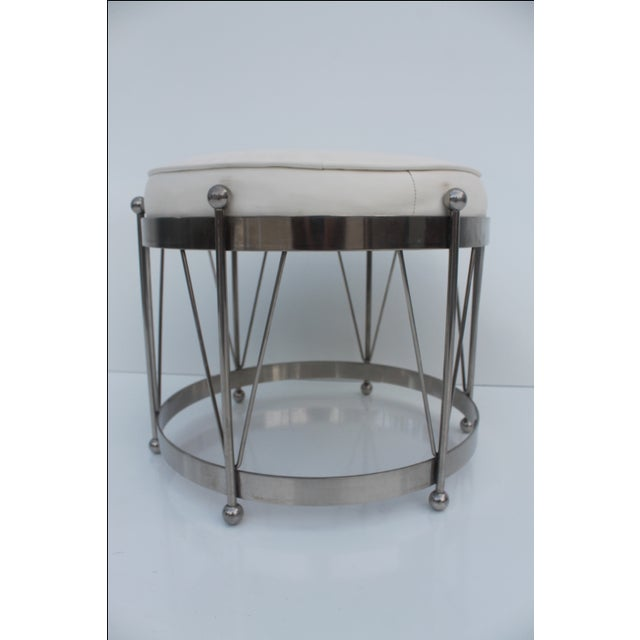 A vintage chrome plated metal drum style stool with vinyl upholstery, made in USA by George Koch. Labeled. A great mid-...