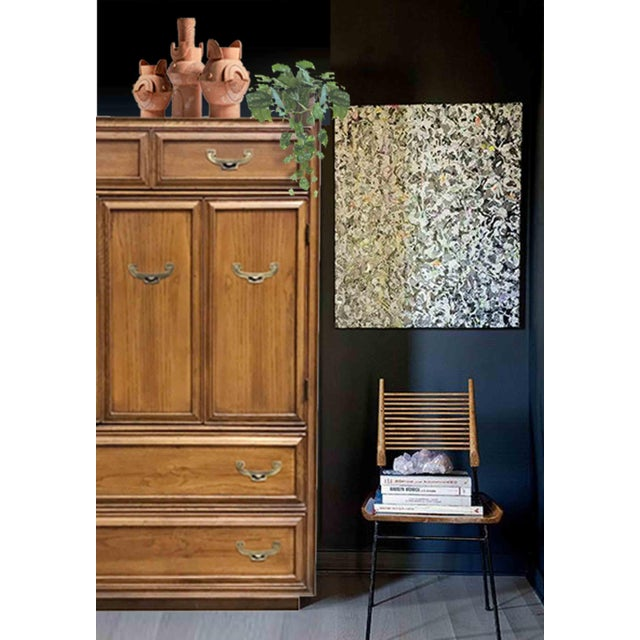 We love the strong quiet presence of this classic campaign armoire. With 7 drawers it provides ample storage with style....