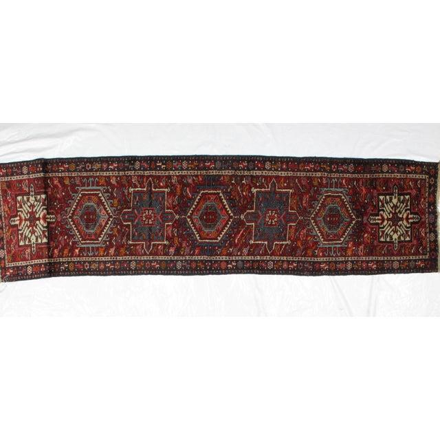 Wool pile genuine handmade Persian Heriz runner. The piece is from the 1950s.
